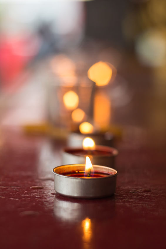 Lignting-of-Praying-candles-in-a-temple.jpg
