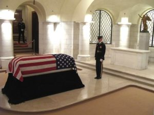 Military Service with Solider standing at the casket