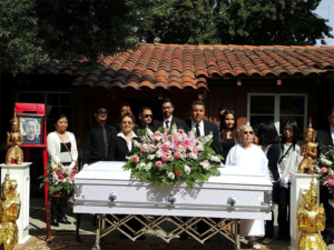 Ralph Torres with family in front of casket